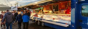 hamburg foodtruck panorama 300x102 - Hamburg, Germany - November 11, 2018: Altona Fish Market With Unidentified People. The Fish Market I