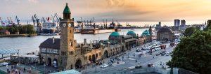 hamburg tyskland panorama 300x106 - View Of The St. Pauli Piers One Of Hamburgs Major Tourist Attractions